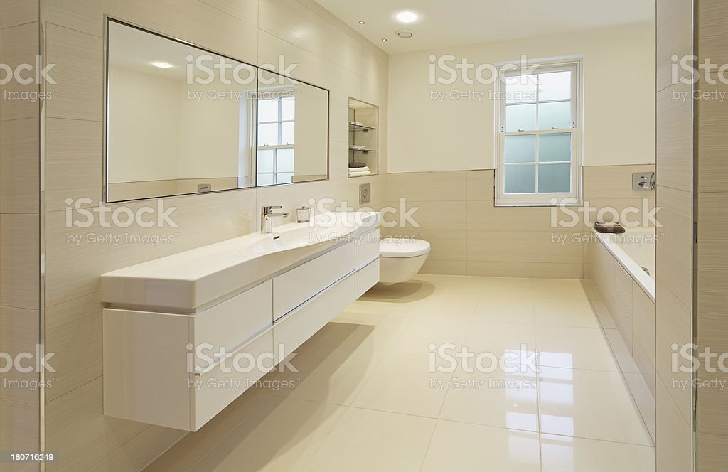 large cream coloured gust's bathroom stock photo