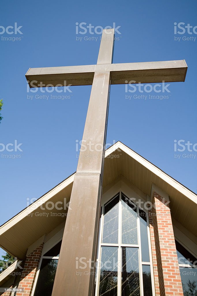 Large Cross in Front of Church Blue Sky stock photo