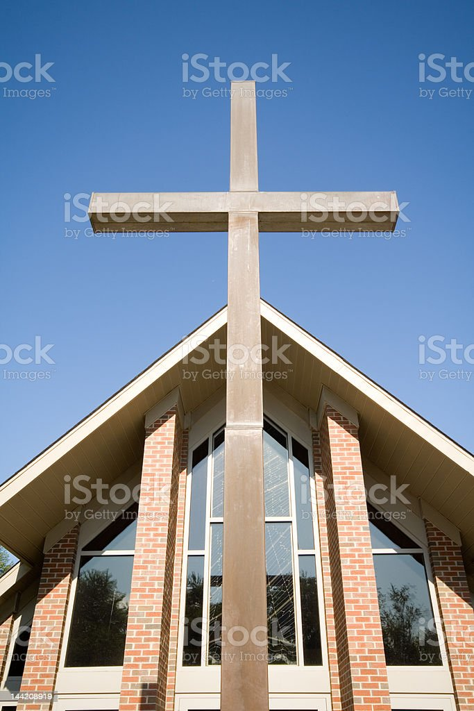 Large Cross in Front of Modern Church Roof Blue Sky royalty-free stock photo