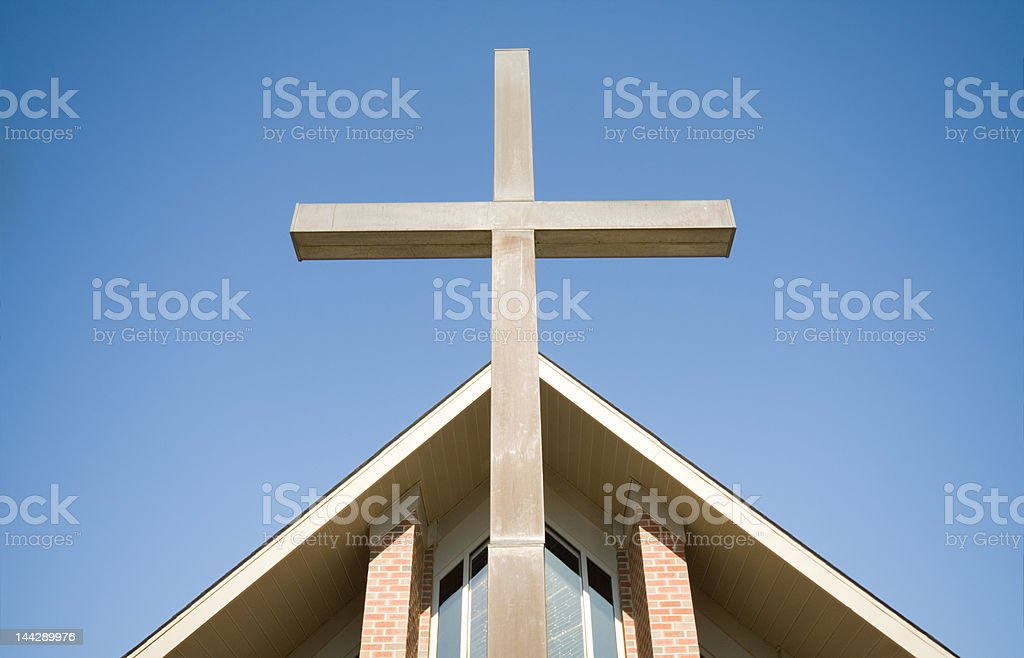 Large Cross on Exterior of Modern Church Blue Sky stock photo