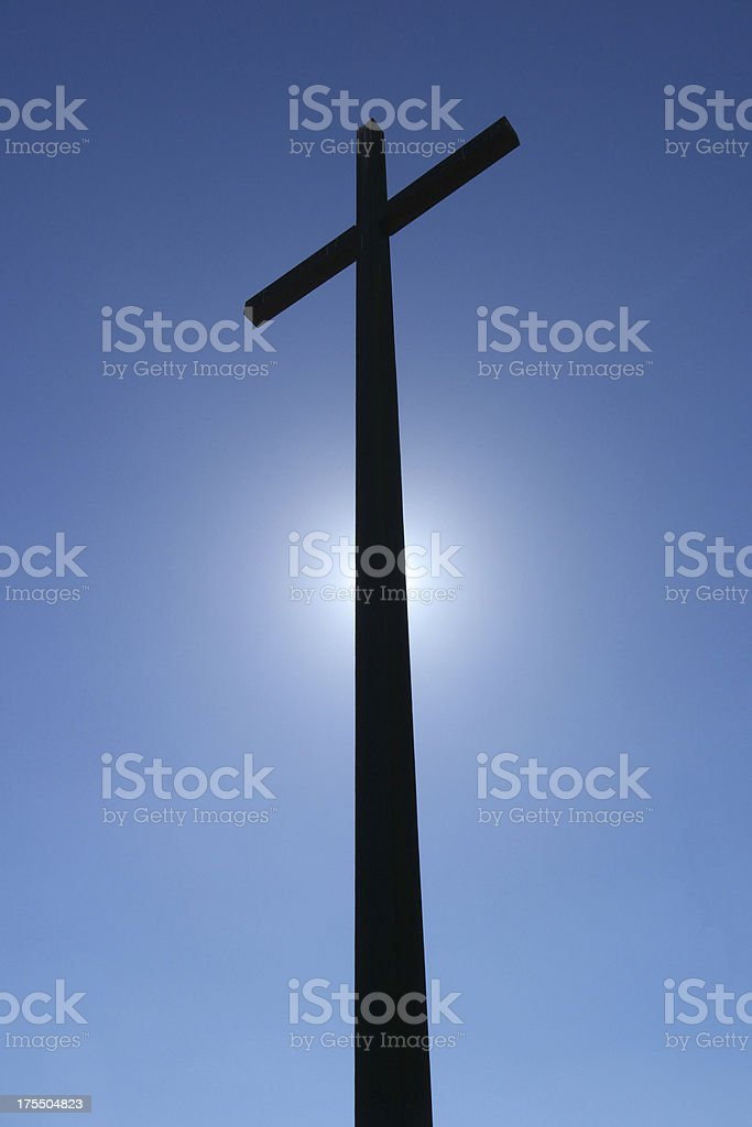 Large cross with a clear blue sky background. royalty-free stock photo