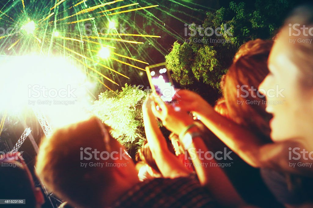 Large crowd enjoying firewroks. stock photo