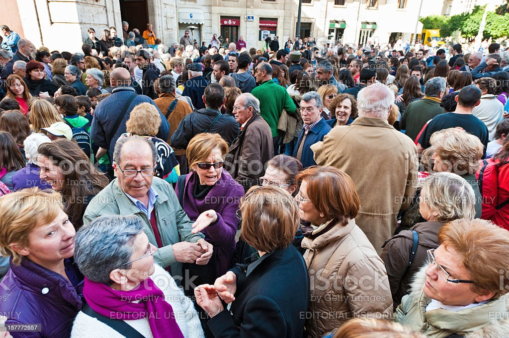 Large crowd of people all ages in street Spain stock photo
