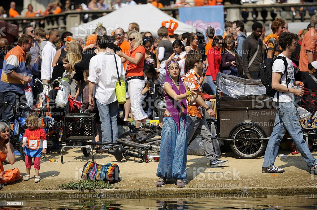 Large crowd of people in the Vondelpark on Queen's day royalty-free stock photo