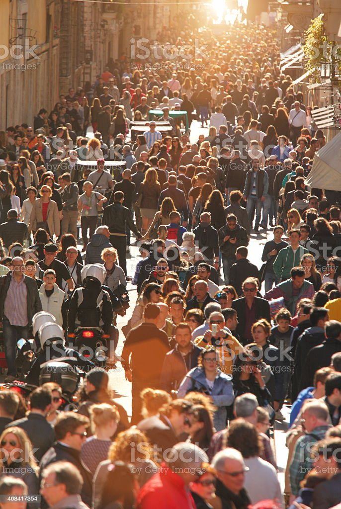 Large crowd of people on street in downtown Rome, vertical stock photo
