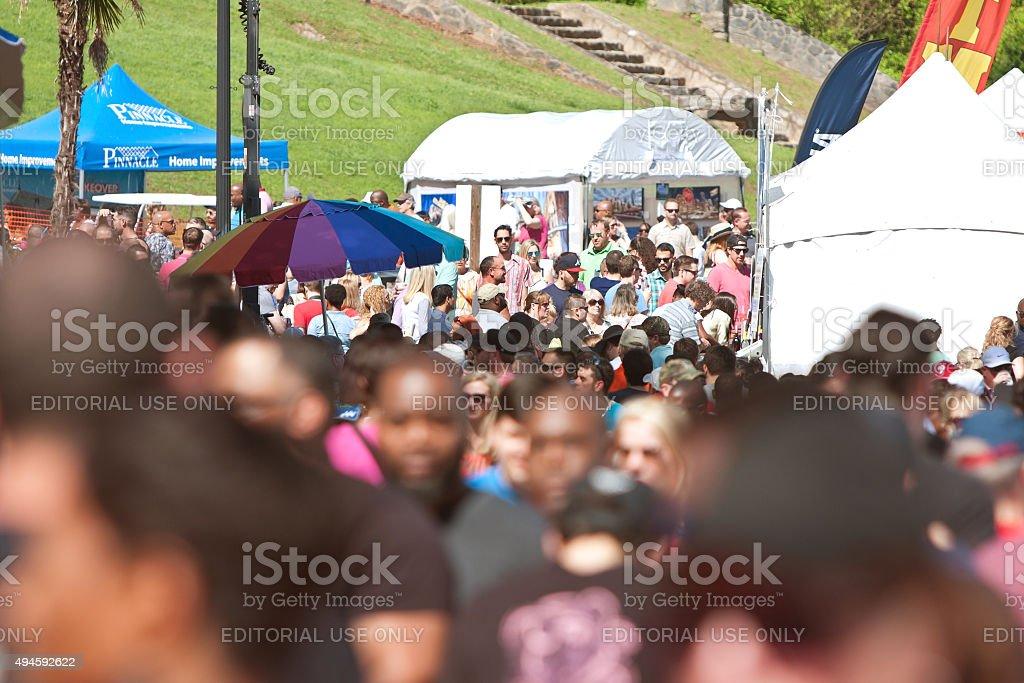 Large Crowd Of People Walks Through Atlanta Dogwood Festival stock photo