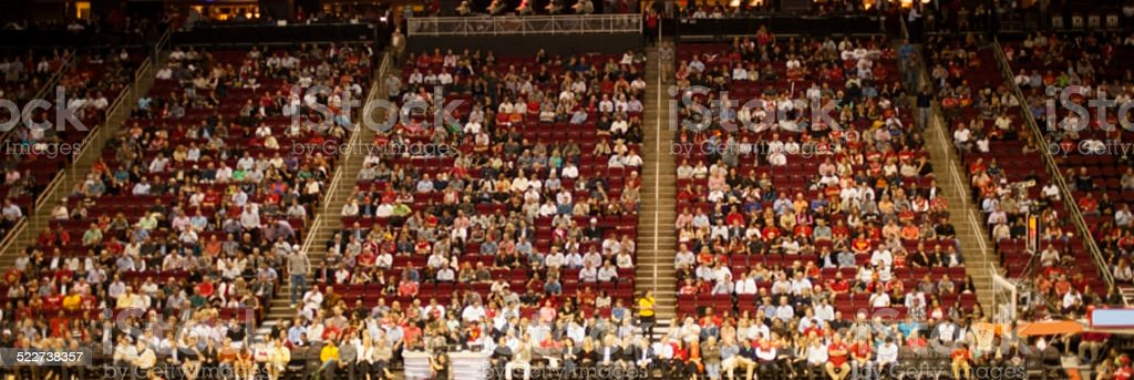 Large crowd of unrecognizable people attend entertainment event. Stadium. stock photo