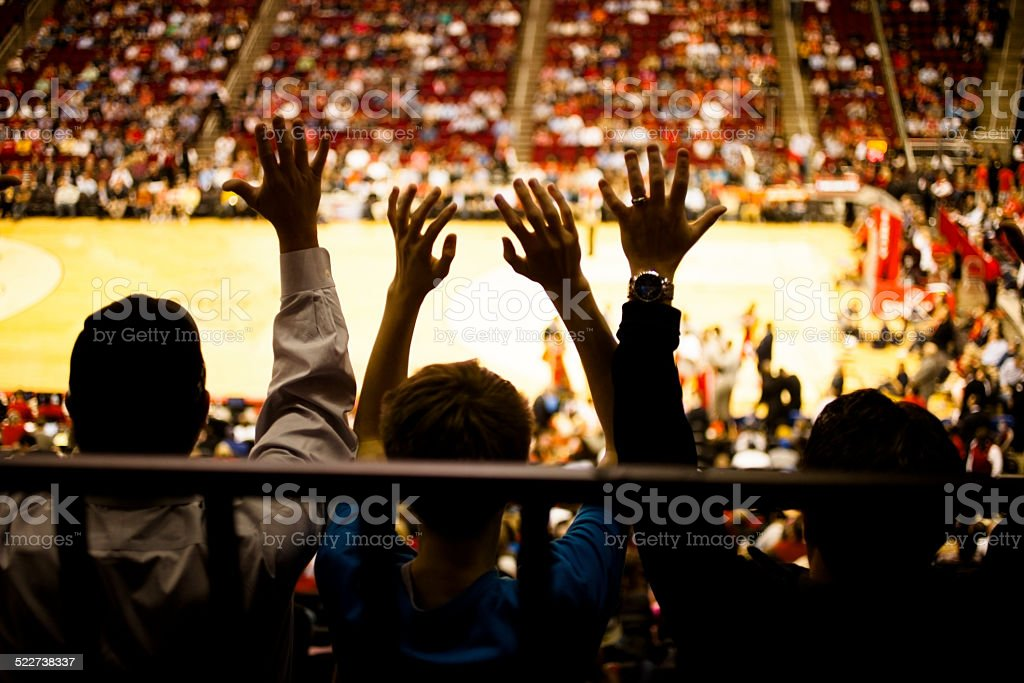 Large crowd people attend a sports event. Stadium. Basketball court. stock photo