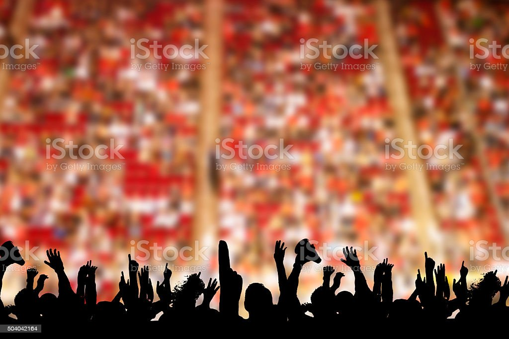 Large crowd people attend a sports event. Stadium. Fans. stock photo
