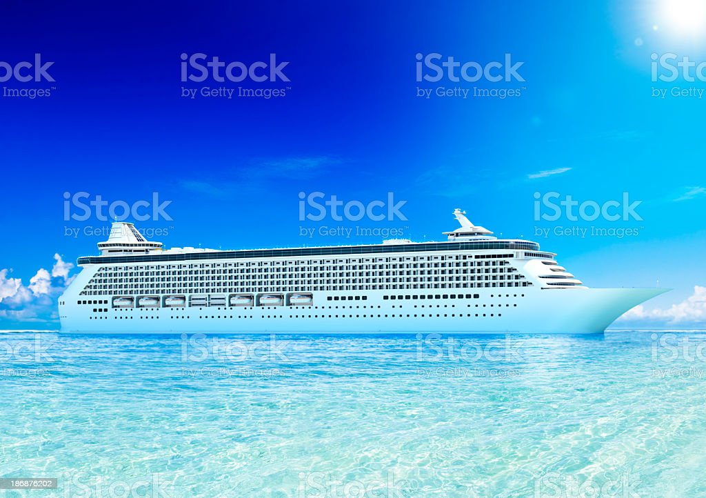Large cruise ship on crystal clear water under blue sky  stock photo