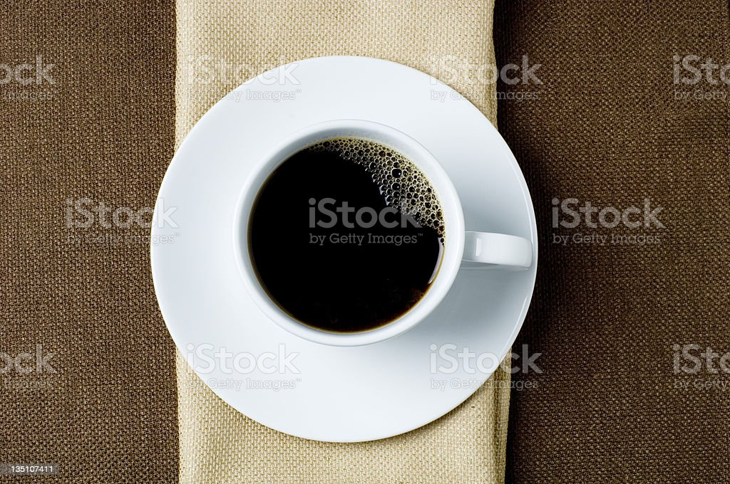 A large cup of black coffee on a white saucer royalty-free stock photo