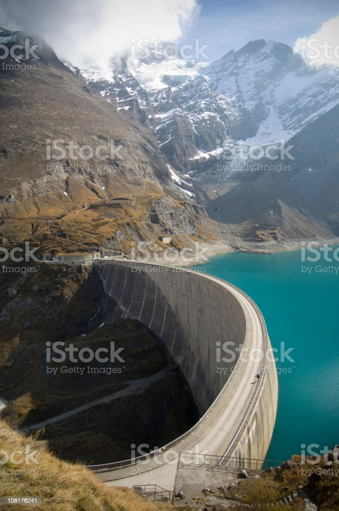 Large Dam in Middle of Mountain Valley stock photo