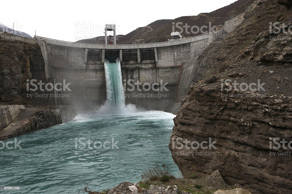 A large dam spillway that is flowing water royalty-free stock photo