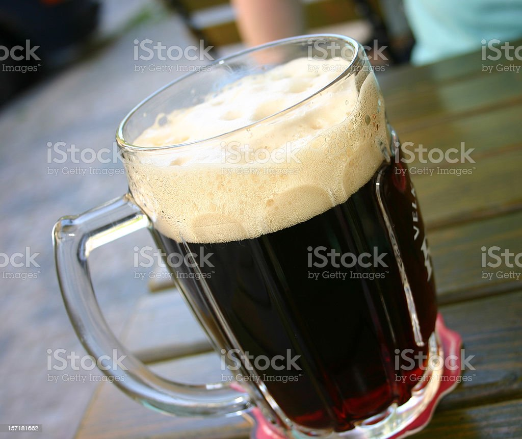 Large Dark Beer glass Prague royalty-free stock photo
