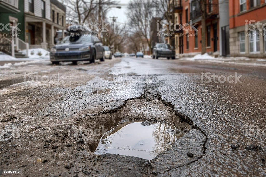 Large deep pothole in Montreal street, Canada. stock photo