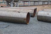 Large diameter pipes lying on gravel