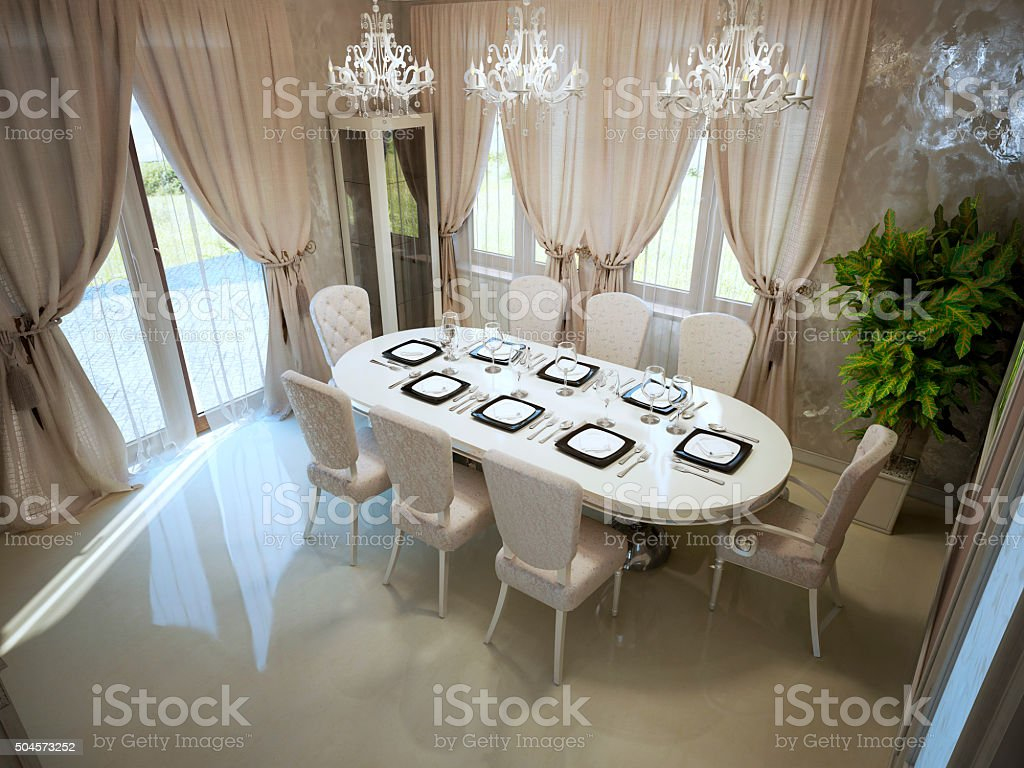 Large dining table in spacy room stock photo