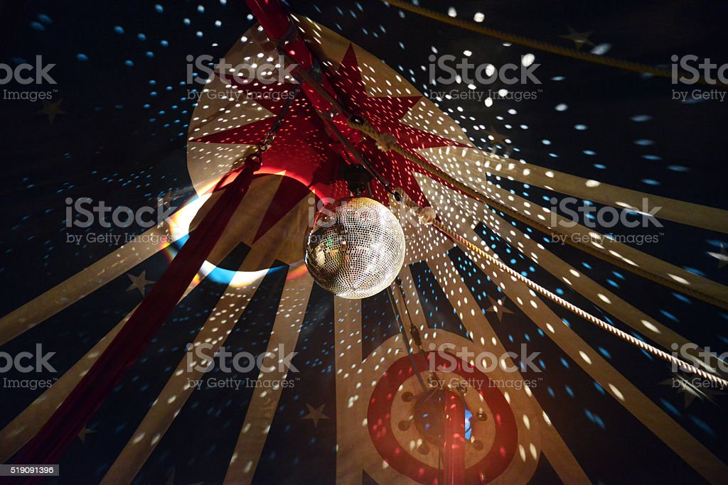 Large Disco Ball With Light Effects In Circus Tent stock photo