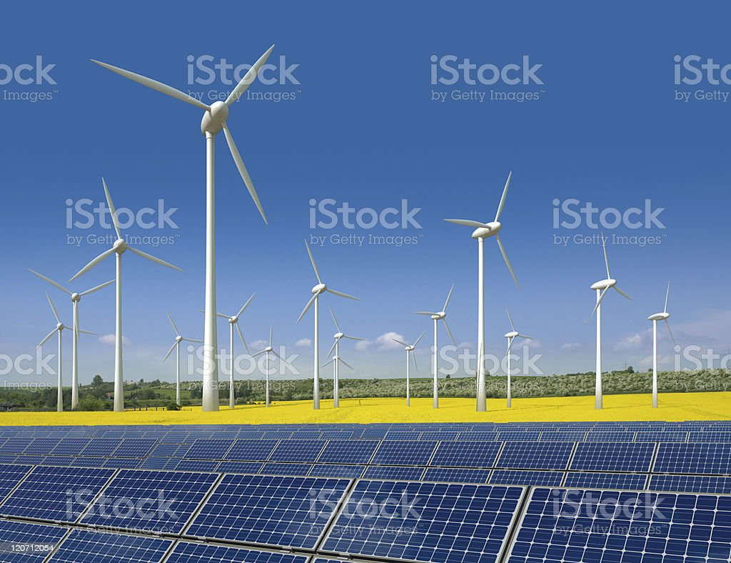 A large display of wind turbines and solar panels outdoors stock photo