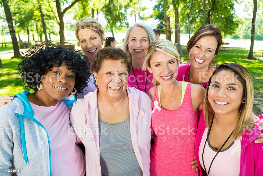 Large diverse group of breast cancer survivors at race stock photo