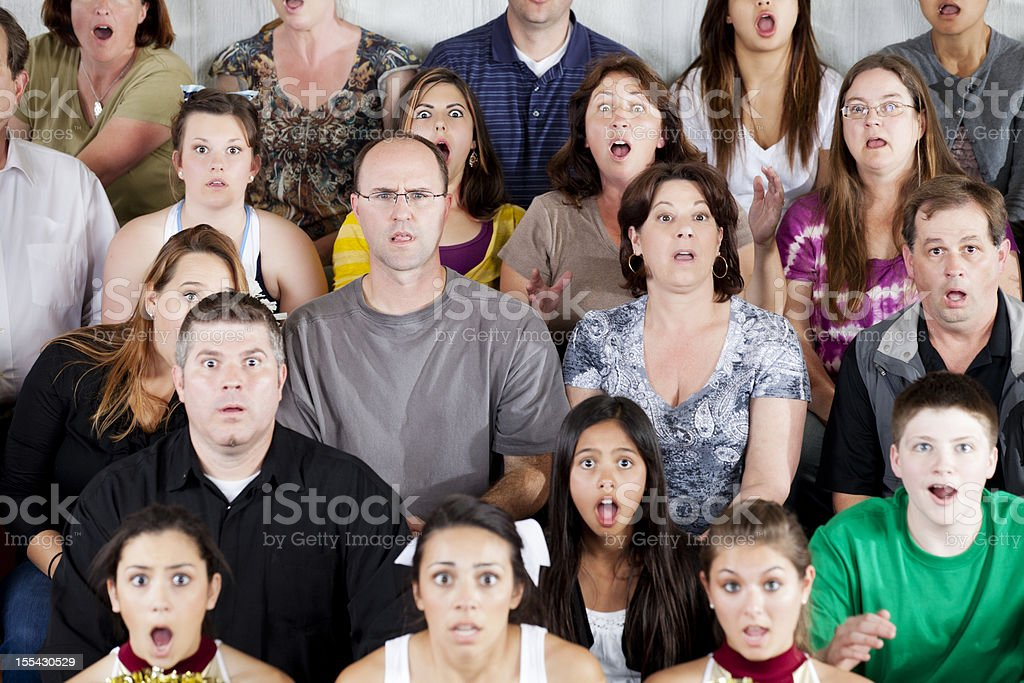 Large diverse group of people shocked at the game stock photo