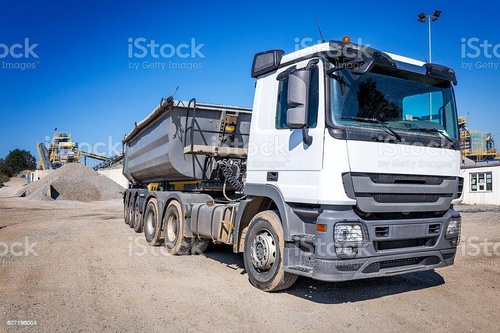 Large dump truck in stone mine stock photo