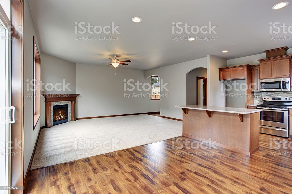 Large empty living room interior connected with kitchen room. stock photo