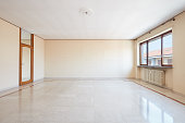 Large empty living room interior with marble floor
