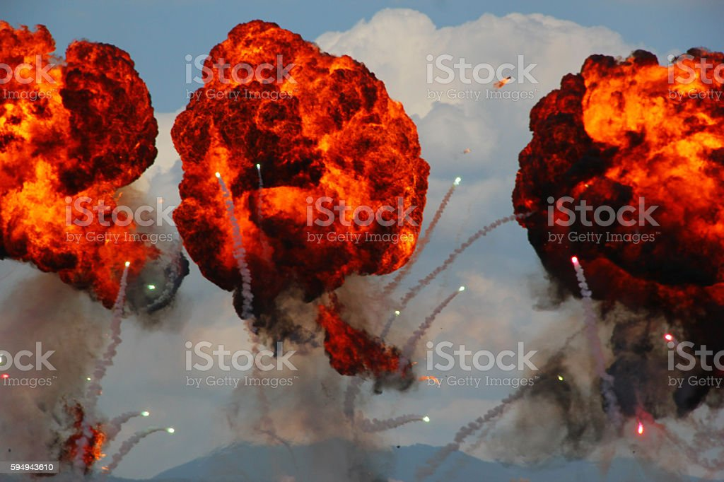 Large explosion made by fire bomb drops at an airshow stock photo