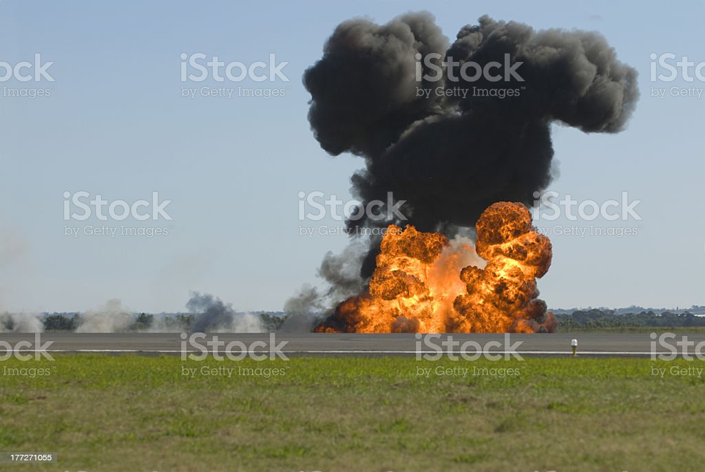 Large explosion on an airport runway. royalty-free stock photo