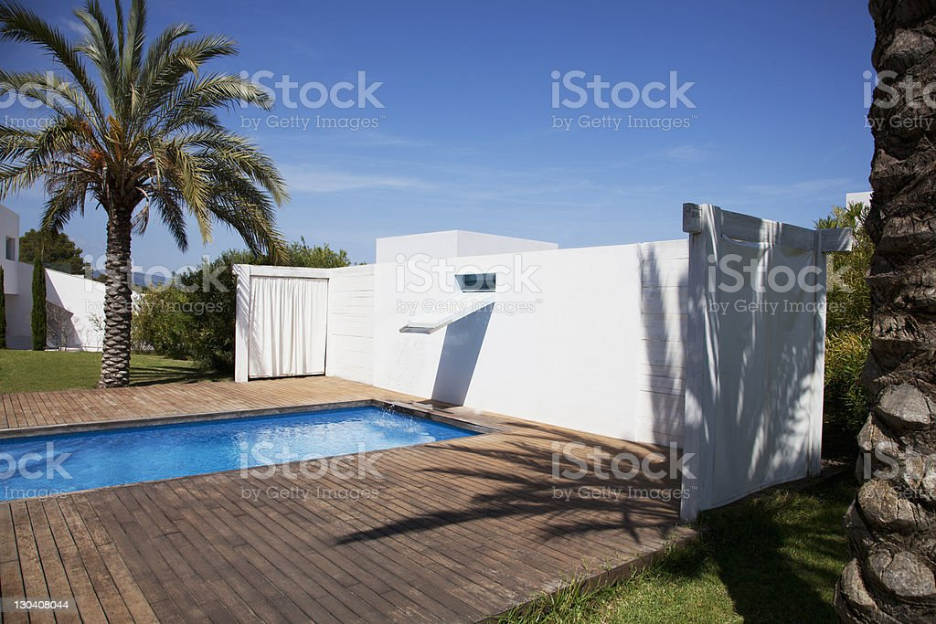Large eyes in windows overlooking pool royalty-free stock photo