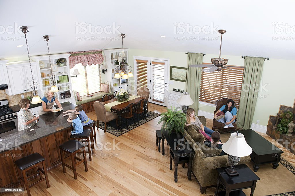 Large family gathering in luxury home (High Angle) stock photo