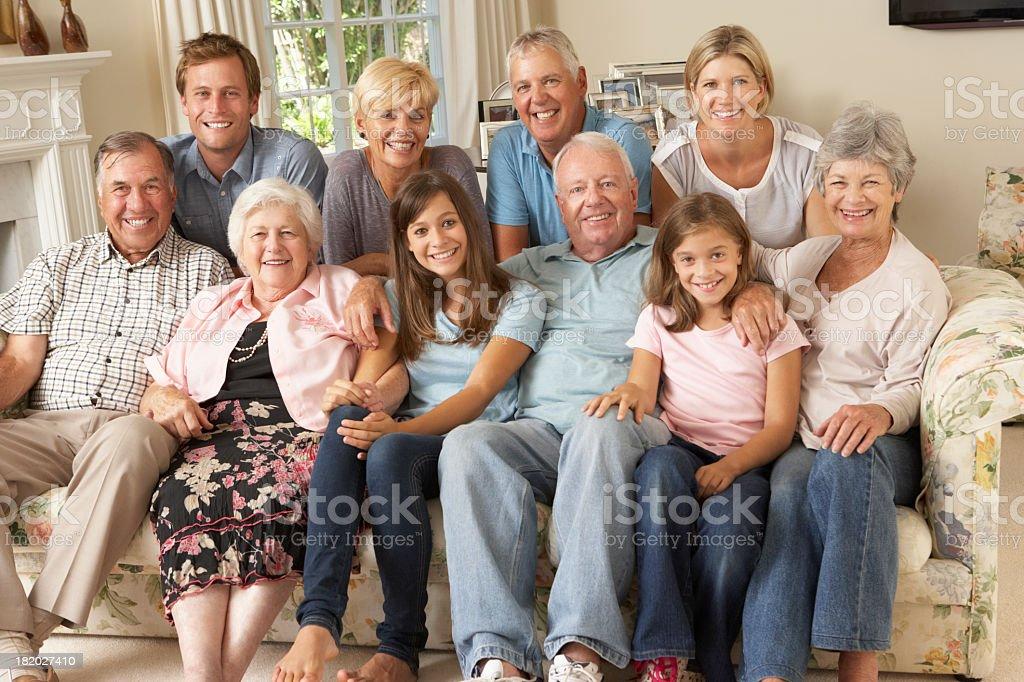 Large Family Group Sitting On Sofa Indoors royalty-free stock photo
