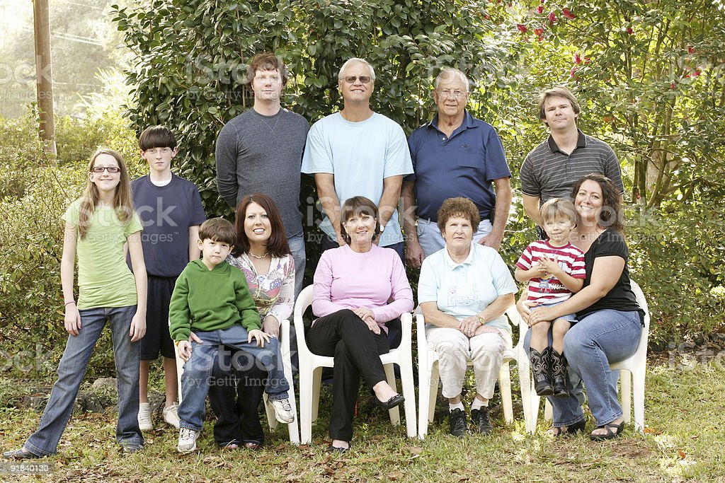 Large family portrait in the garden stock photo