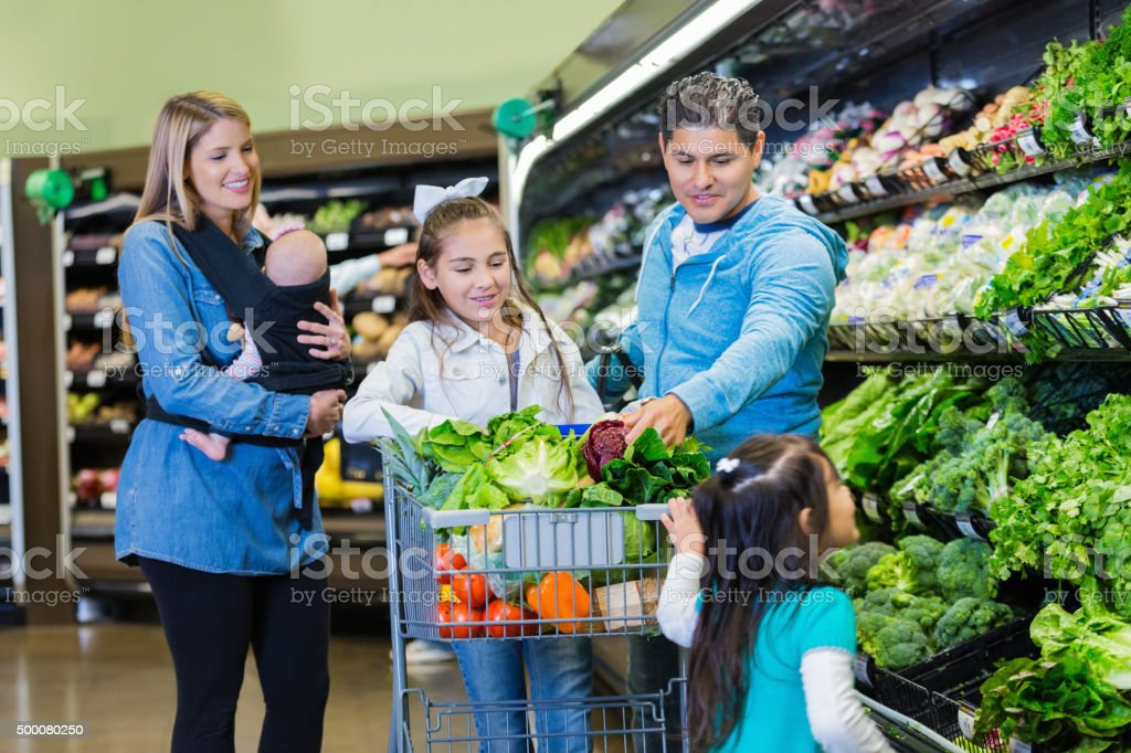 Large family shopping for groceries together in supermaket stock photo
