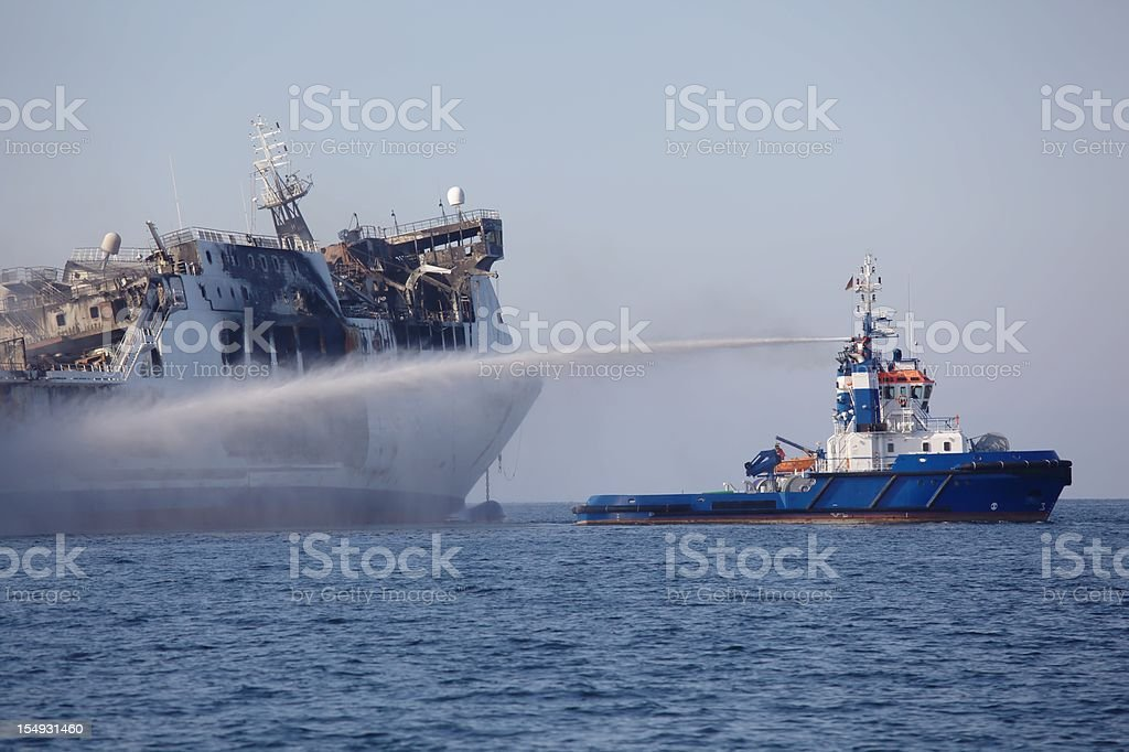 A large ferry boat that caught on fire previously  stock photo