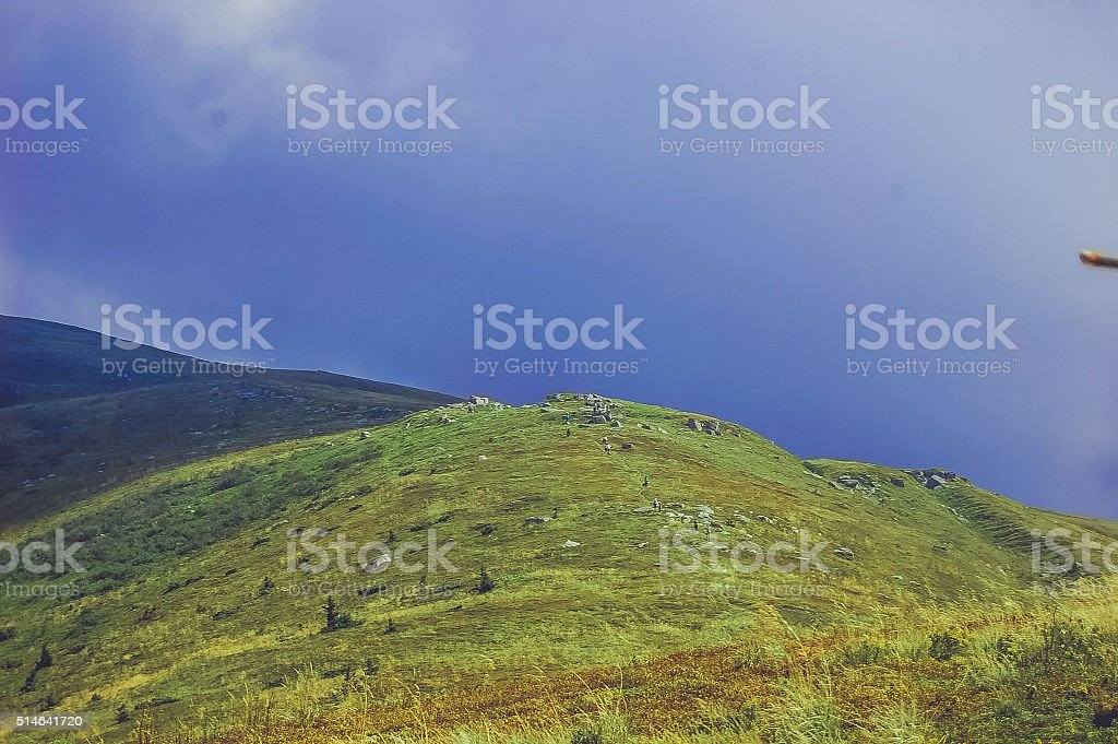 large field in the mountains stock photo