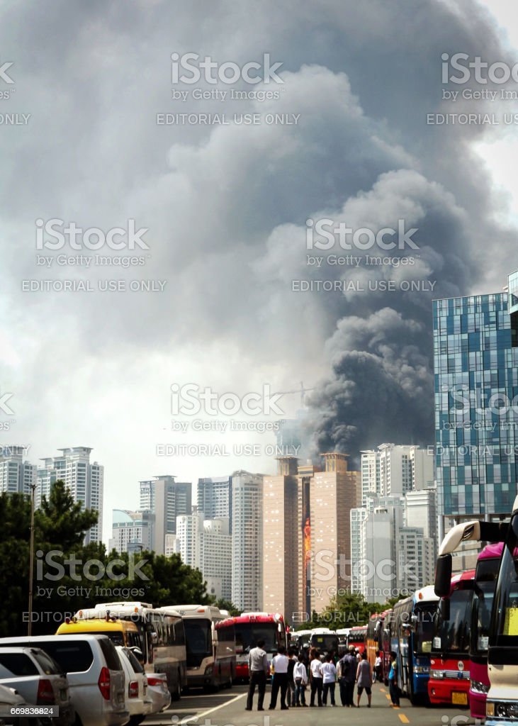 Spectators watching a large fire at a building in Busan, Korea. The...