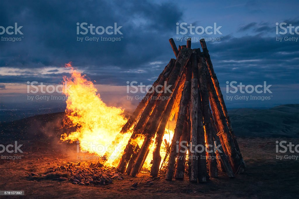 Large fire beacon burning on hilltop stock photo