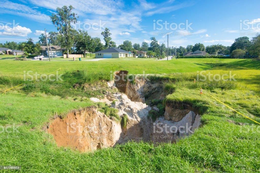 Large Florida Sinkhole Near Residential Neighborhood stock photo