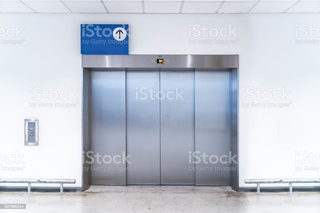 Large freight elevators in modern building stock photo