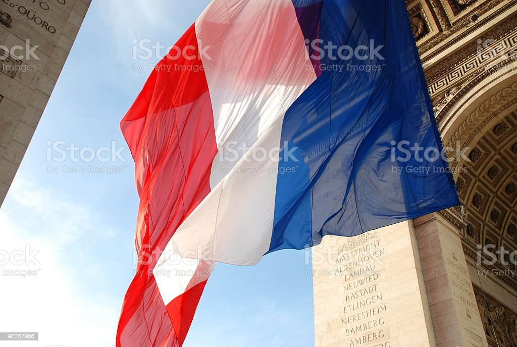 Large French flag blowing in the wind stock photo