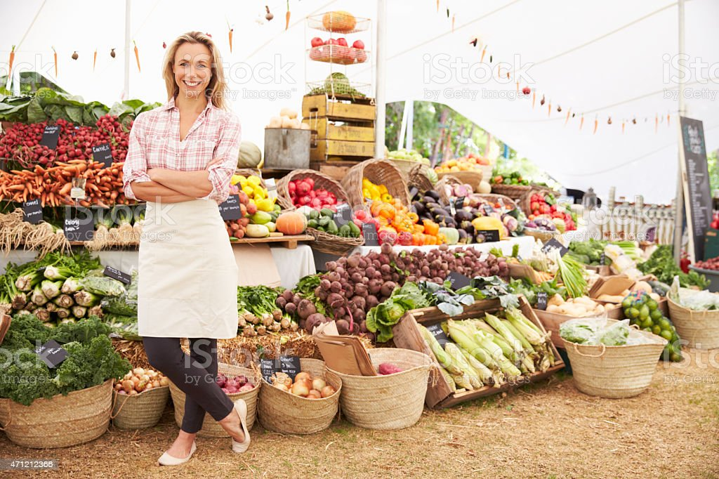 Large fresh food market with employee stock photo