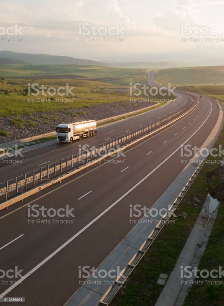 Large gas tank driving on the highway stock photo