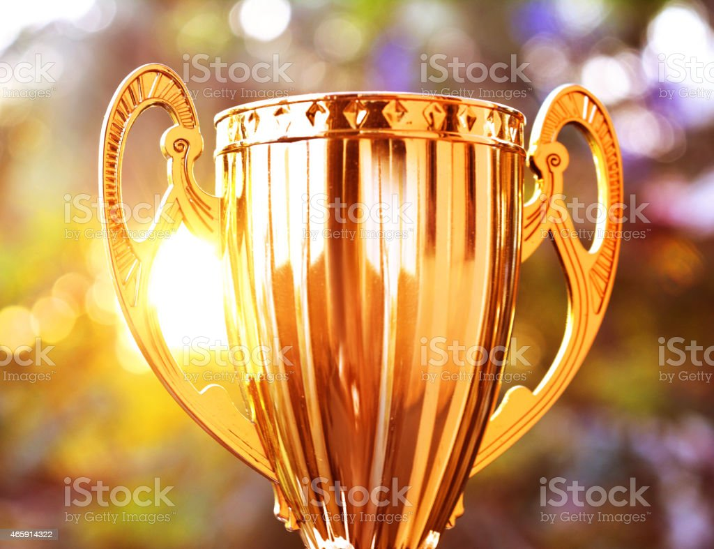 Large gold trophy in the sunshine stock photo