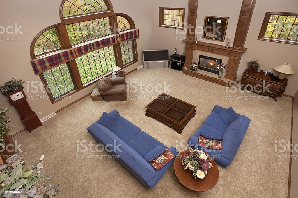 Large Great Room Looking Down, Blue Sofa, Love Seat, Fireplace royalty-free stock photo