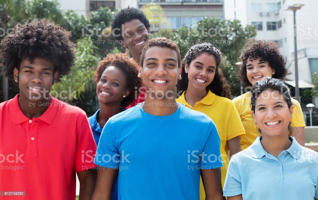 Large group of attractive multiethnic young adults stock photo