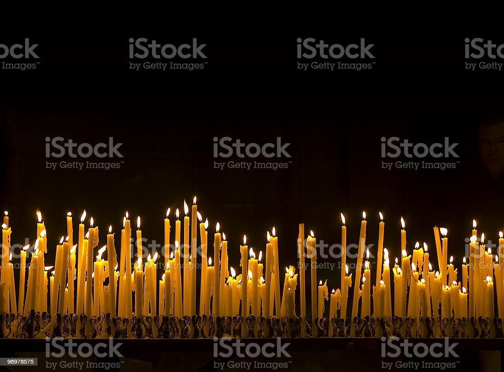 Large group of burning candles stock photo