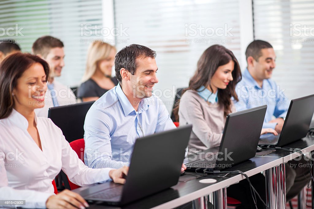 Large group of business people at computer seminar. stock photo