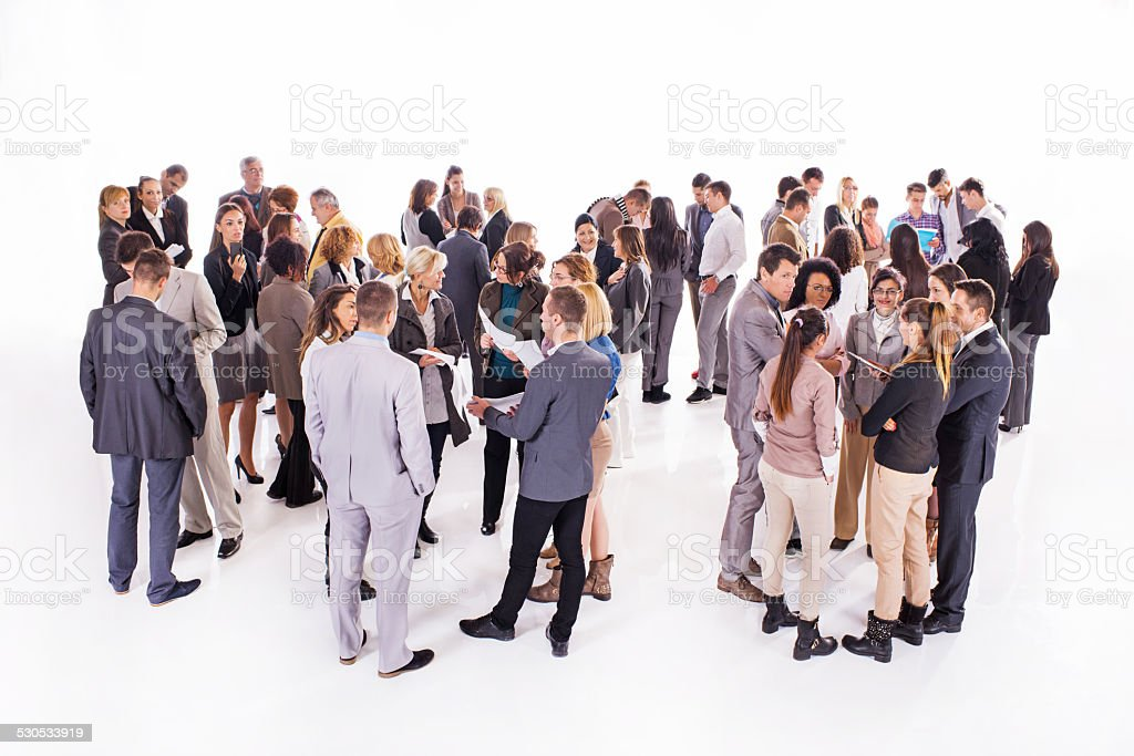 Large group of business people communicating. stock photo
